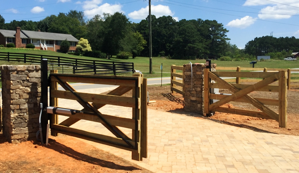 wood_driveway_gate_with_metal_frame_for_gate_opener